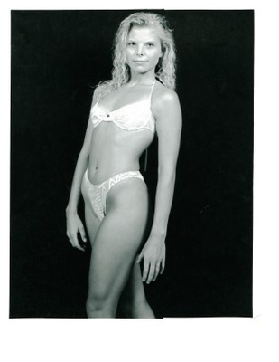 model blonde swimsuit light on black bg 1991