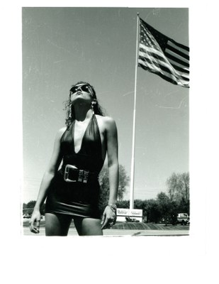model brunette black dress with flag 1991