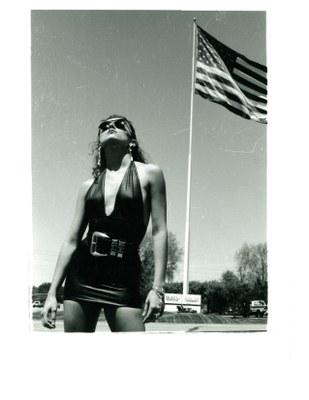 model brunette black dress with flag 1991