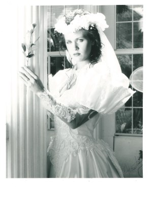 model brunette wedding dress and rose 1991