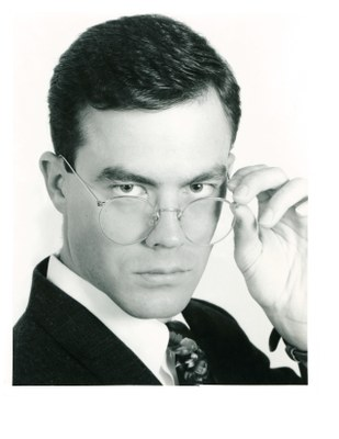 model male glasses dark hair headshot 1991